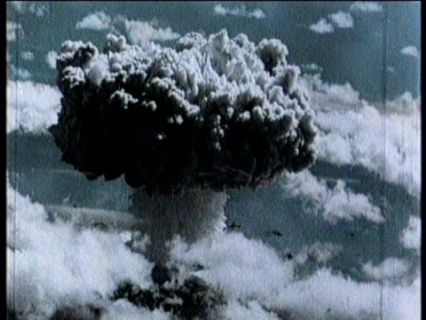newsreel / atomic bomb detonated at bikini atoll in the marshall islands / sailors on ship loading evacuate into smaller watercraft / soldier giving... - radioaktiver niederschlag stock-videos und b-roll-filmmaterial