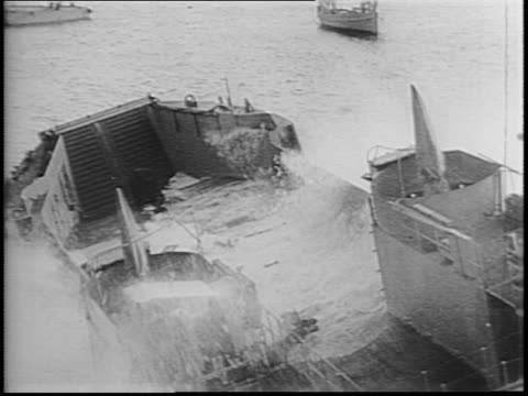newsreel / british navy shipyard boats cast out to sea preparing for invasion / navy vessels line up in formation ready for attack of the coast of... - marine stock-videos und b-roll-filmmaterial