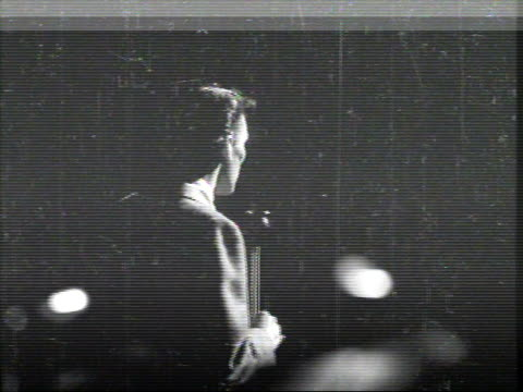 newsreel / camera shooting the back of frank sinatra singing on stage / - frank sinatra stock videos & royalty-free footage