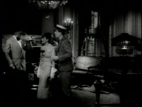 Newsreel / Cameras roll inside Paramount Studios as WC Fields performs a scene with two other actors / Camera and set begin to shake / A lamp falls...