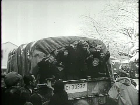 vídeos de stock e filmes b-roll de newsreel / cold war / military evacuate children in greece during civil war in 1949 / children loading into military vehicles / children at back of... - civil