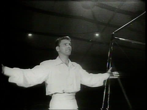 newsreel / cold war / title card reads: burt lancaster - back to the big top / burt lancaster returns to the circus for cole brothers circus show in... - hair back stock videos & royalty-free footage
