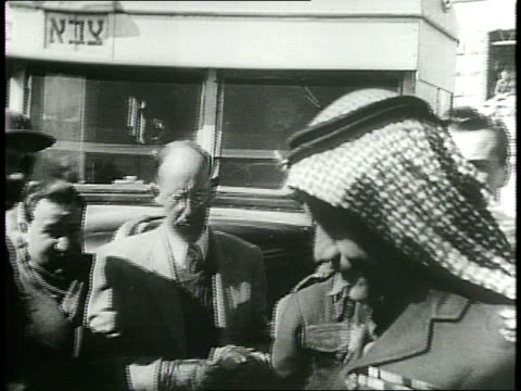 newsreel / cold war / title card reads: jerusalem - israel, arabs begin exchange of prisoners! / 153 prisoners of war held by israel are turned over... - israel stock videos & royalty-free footage