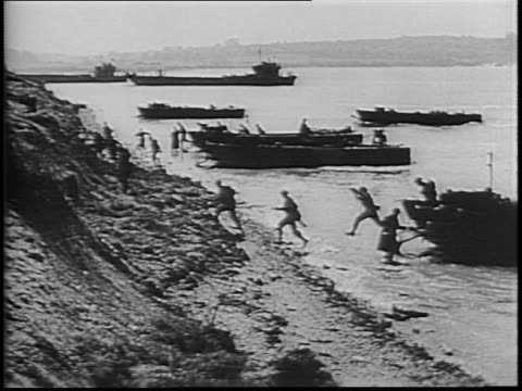 newsreel / dday footage / allied battleships bomb the enemy coastline while infantry moves towards the coast of enemy territory / allied infantry... - normandie stock-videos und b-roll-filmmaterial
