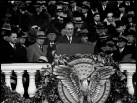 stockvideo's en b-roll-footage met newsreel / highlights of the inauguration speech by franklin d roosevelt at the podium / discussion of money and federal emergencies / crowd cheers... - 1933