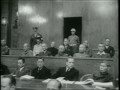 newsreel / japanese war lords face justice / at the international military tribunal for the far east / japanese prisoners inside the courtroom /... - war stock videos & royalty-free footage