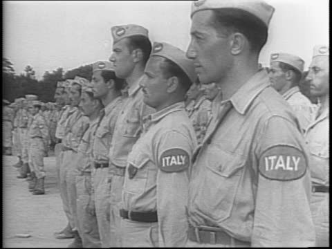 newsreel / mussolini's army surrendering in africa / italian prisoners of war at camp sutton in north carolina / various shots of the men in the new... - benito mussolini stock videos & royalty-free footage