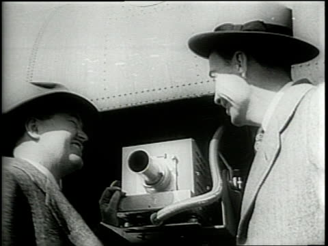 newsreel / narrated / airborne television is demonstrated at anacostia naval station / a bomber plane has a television camera in it's nose / an... - television show stock videos & royalty-free footage