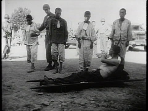 newsreel / narrated / american soldiers travel through daegu and witness the casualties left behind by north korea's army / injured korean soldiers... - korean war stock videos & royalty-free footage