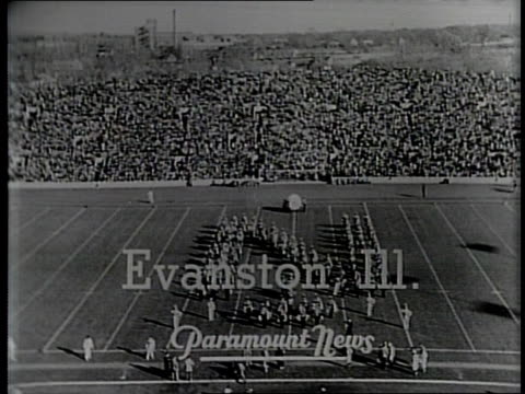 newsreel / narrated / college football northwestern vs minnesota in evanston illinois / highlights from the game include northwestern scores a... - narrating stock videos & royalty-free footage
