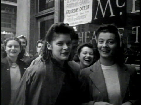vídeos de stock, filmes e b-roll de newsreel / narrated / crowd and security at sinatra concert / bobby-soxers in line to see sinatra / close up of women's shoes walking through water /... - narrating