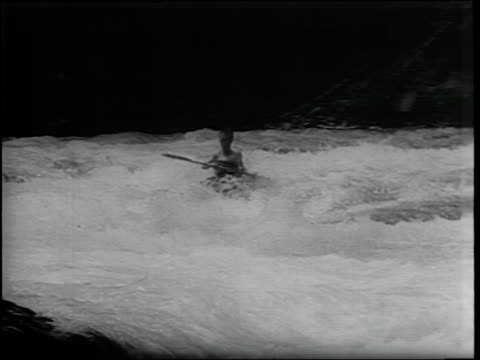 stockvideo's en b-roll-footage met newsreel / narrated / five kayakers race down the bavarian alps / the racers have to dodge rocks and dangers / a racer loses his kayak / the racer... - bavarian alps