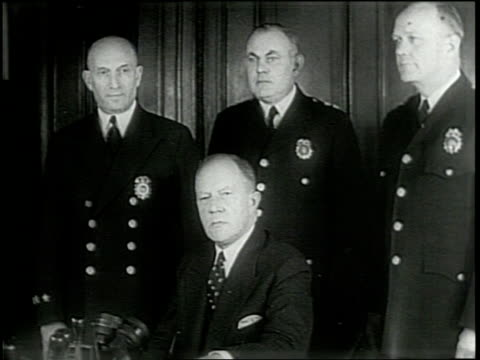 newsreel / narrated / general mcarthur welcomes lewis j valentine to tokyo / they walk down stairs together and both enter a vehicle / valentine is... - fire department of the city of new york stock videos and b-roll footage