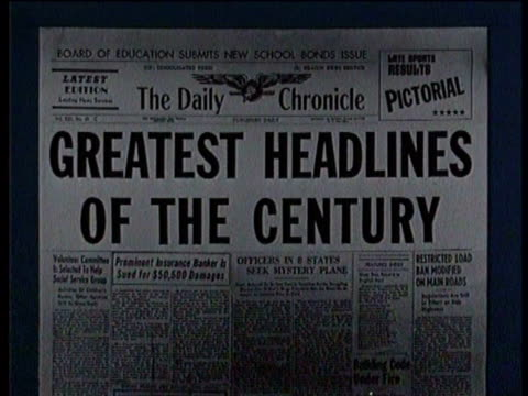 vídeos de stock, filmes e b-roll de newsreel / narrated / greatest headlines of the century / newspaper headline from the newschronicle reads hitler - primeira página de jornal