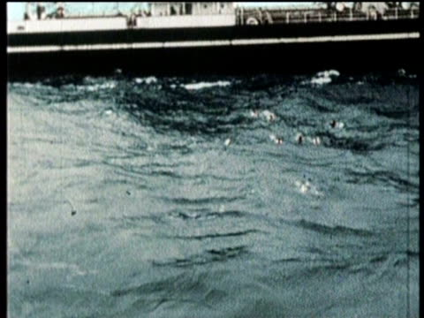 newsreel / narrated / greatest headlines of the century / the ss andrea doria sinks in the atlantic ocean in 1956 after crashing into the stockholm... - sos stock videos and b-roll footage