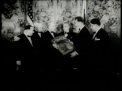 newsreel / narrated / herbert hoover is celebrated by crowds at various locations / secretary of the treasure tom snyder awards herbert hoover with... - narrating stock videos & royalty-free footage