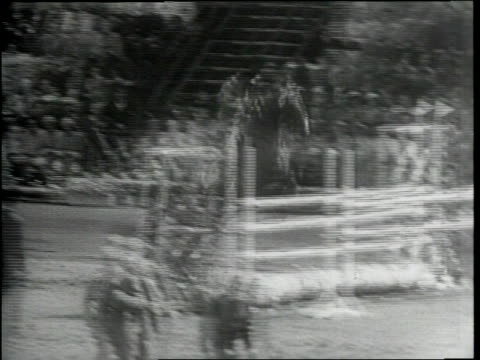 newsreel / narrated / horseback riders competing in final event of the equestrian olympics in sweden / competitors jump their horses over various... - recreational horseback riding stock videos & royalty-free footage