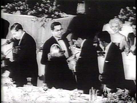 Newsreel / Narrated / Jerry Lewis and Dean Martin are honored at the annual Dinner of the Friars for their efforts with the Muscular Dystrophy...