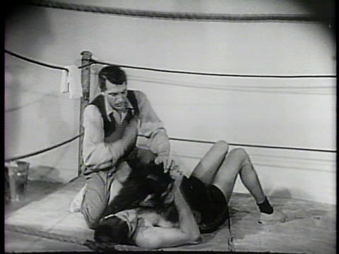 Newsreel / Narrated / Jerry Lewis takes a real beating and finally loses in a comedic wrestling match with Pierre the chimpanzee / Chimpanzee wraps...