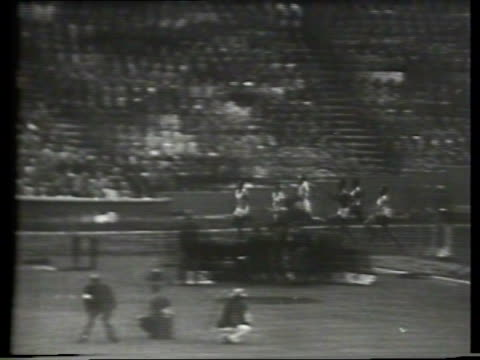 newsreel / narrated / male athletes compete in olympic shot put during the 1948 london olympics at wembley stadium / american wilbur thompson... - 1948 stock-videos und b-roll-filmmaterial