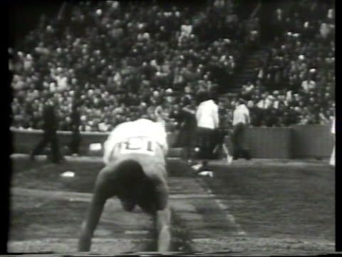 newsreel / narrated / male athletes competing in the men's triple jump event for the 1948 london olympics / brazilian athlete geraldo de oliveira... - narrating stock videos & royalty-free footage