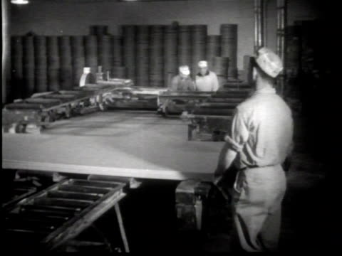 newsreel / narrated / paramount news / industry on parade / introduction to the making of sheet rock and gypsum refinement in clarence center new... - industrie ofen stock-videos und b-roll-filmmaterial