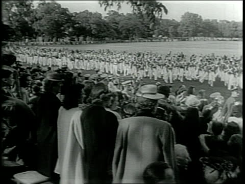 Newsreel / Narrated / Paramount News / Title card reads FOR A STRONG AMERICA 875 NEW ARMY OFFICERS / 875 West Point cadets become officers at West...