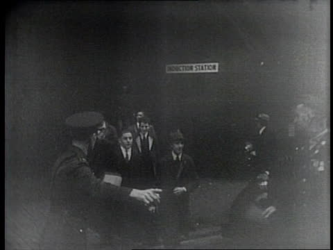 vídeos de stock e filmes b-roll de newsreel / narrated / paramount news / title card reads so off they go / first draftees in boston take the oath to serve with general woodruff in... - cadete