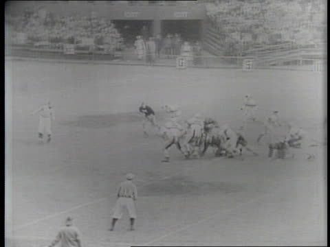 Newsreel / Narrated / Paramount Newsreel / College Football Army vs Notre Dame at Yankee Stadium in New York in 1940 / Narrator in front of...
