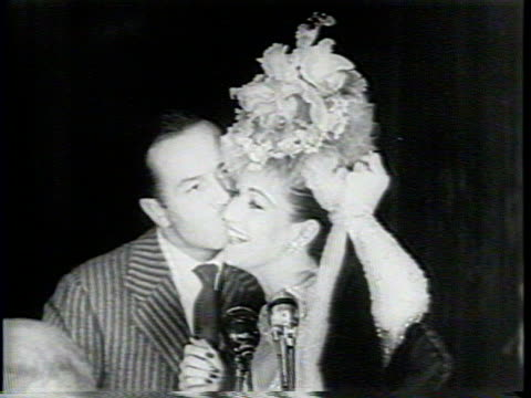 newsreel / narrated / patricia white speaks at a hollywood gala to raise money for the damon runyon cancer research foundation / lon chaney implores... - cheek to cheek stock videos & royalty-free footage