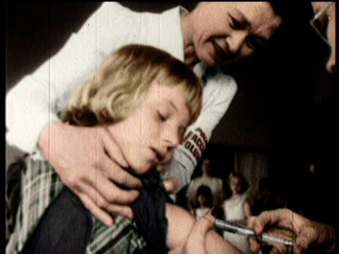 Newsreel / Narrated / Polio / Volunteer doctors and nurses giving children the vaccine shot / Elite doctors and medical research scientists gathering...