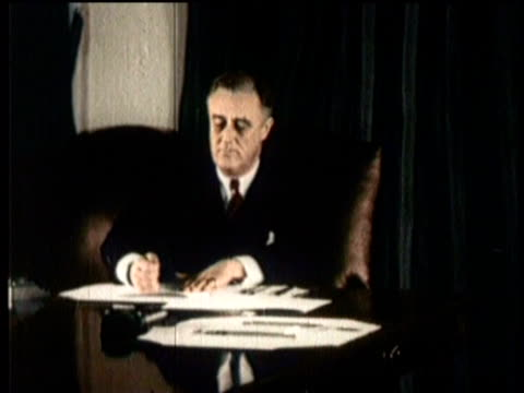 vídeos y material grabado en eventos de stock de newsreel / narrated / prohibition / president roosevelt signs bill repealing prohibition laws on december 5 1933 in washington dc / outside the u s... - franklin roosevelt