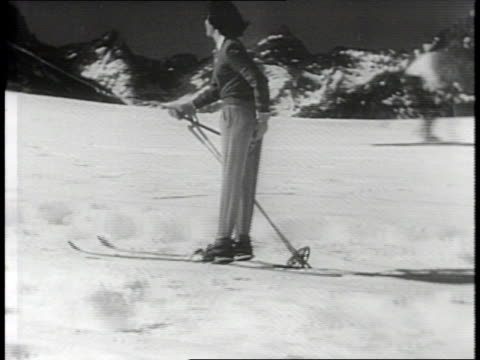 newsreel / narrated / skiers stay at the portillo resort in the andes mountains of chile / tourists lounge on the large patio of the resort's hotel /... - nordic skiing event stock videos and b-roll footage
