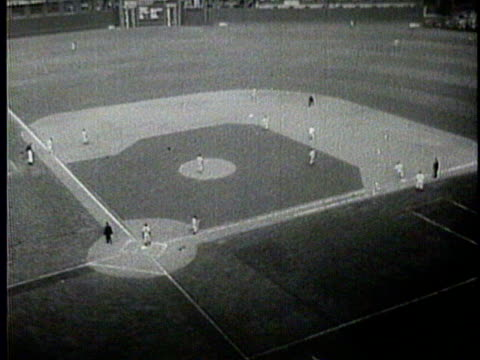 newsreel / narrated / the stands at crosley field are packed for the 1940 world series / a player is up to bat / billy myers makes a hit that sends... - narrating stock videos & royalty-free footage