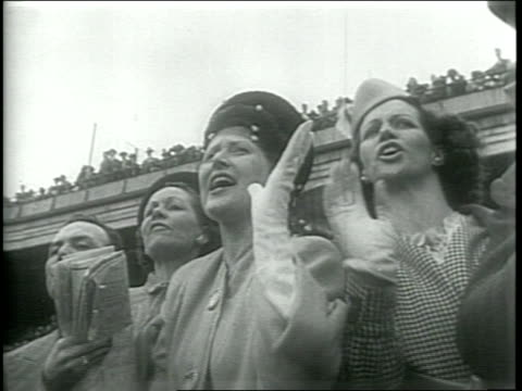newsreel / narrated / thousands of people enter churchill downs for the kentucky derby / spectators drink mint juleps / first lady mary margaret... - first lady stock videos & royalty-free footage