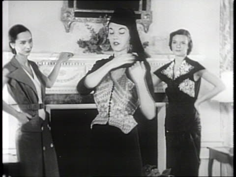 vidéos et rushes de newsreel / narrated / three women model ceremonial robes and gowns from israel / woman enters room wearing a trouser skirt dress highlighting a... - vêtement traditionnel