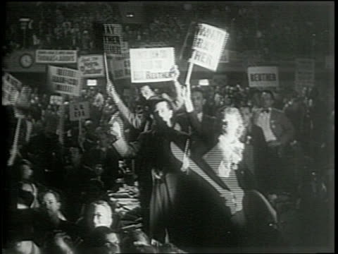 newsreel / narrated / united automobile workers pick their new president / members wave signs to support their candidates / r j thomas and walter p... - narrating stock videos & royalty-free footage