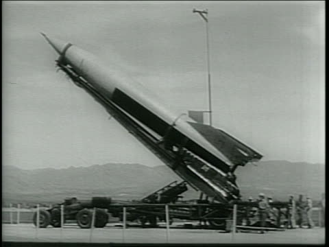 Newsreel / Narrated / V2 rocket is fueling at the testing facility / radar equipment is tested to follow the rocket flight / Army men enter a...