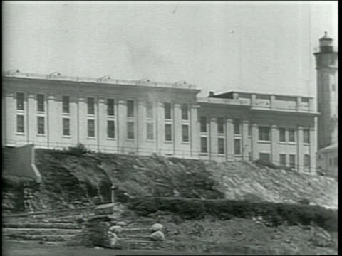 newsreel / narrated / various shots of alcatraz island inside and out / mugshots of the 3 prisoners who tried to escape / prison guards run around... - prison escape stock videos and b-roll footage