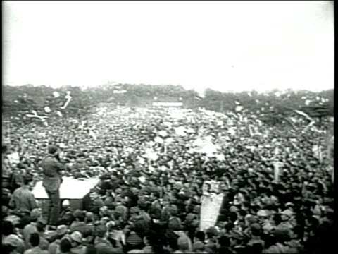 newsreel / narrated / world war 2 / 500,000 people gather outside the emperor's palace in celebration of free speech / various people discuss... - rebuilding stock videos & royalty-free footage