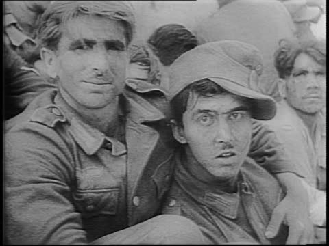 newsreel / nazi prisoners escorted by french colonial soldiers / generals mark clark and charles de gaulle / makeshift prisons / wounded nazi... - prigioniero di guerra video stock e b–roll