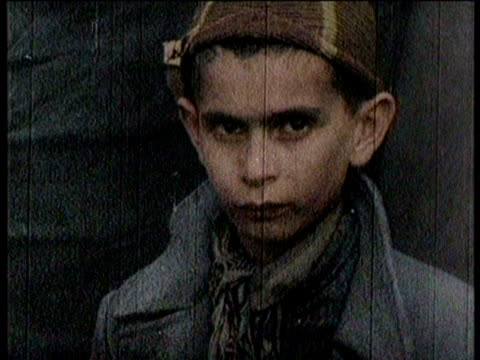 newsreel / no audio / concentration camp victims released from camp / concentration camp victims gathering in a group / close up of various victims / - judaism stock videos & royalty-free footage