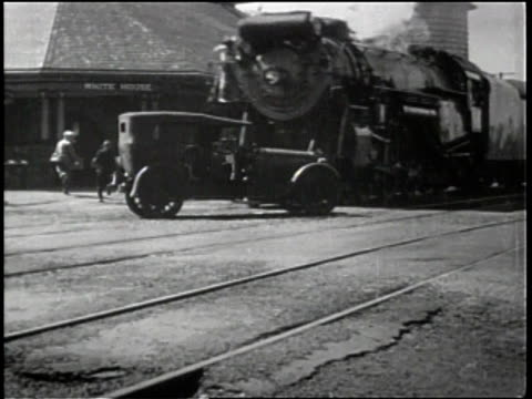 newsreel / no audio / diamond-shaped make-shift sign reads stop railroad crossing look out for the cars / truck driving toward train track barricade... - barricade stock videos & royalty-free footage