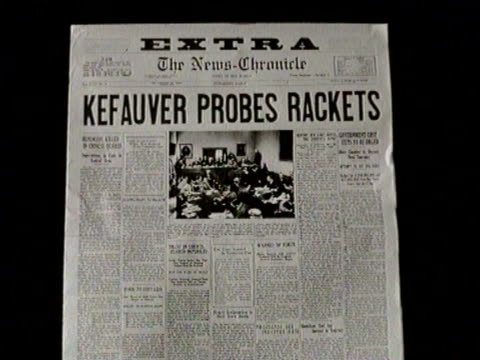 newsreel / no audio / greatest headlines of the century / newspaper headline from the daily-chronicle reads: kefauver probes rackets / senator... - oath stock videos & royalty-free footage