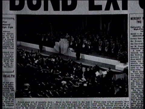 newsreel / no audio / greatest headlines of the century title card turns into newspaper headline / newspaper shown with the headline nazi bund... - drittes reich stock-videos und b-roll-filmmaterial