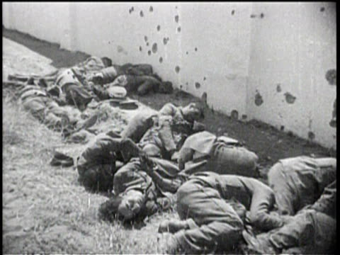 Newsreel / No Audio / Massacre of Badajoz in Spain during the Spanish Civil War in 1936 / Refugees Walk Streets / Bodies In Field / Mass Murder...