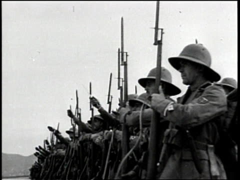 newsreel / no audio / nazi army and officials / thousands of german soldiers stand in formation at attention in the desert / close up of soldiers... - adolf hitler stock videos & royalty-free footage