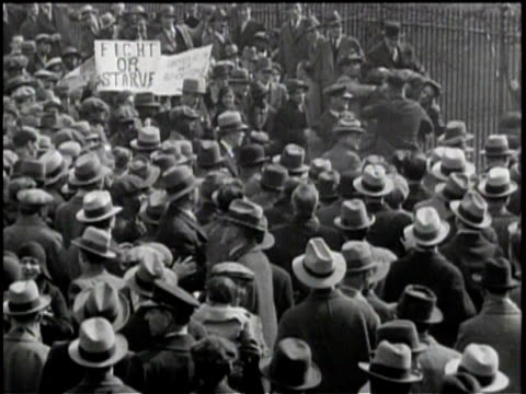 Newsreel / No Audio / Pathe News / Title card reads TEAR GAS ROUTS WHITE HOUSE MOB WASHINGTON March of Communist demonstrators ends in riot broken up...