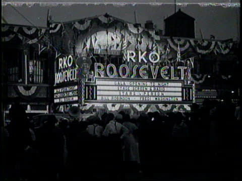 newsreel / no audio/ the marquee of the rko roosevelt in harlem advertises it's opening night including appearances by bill robinson and fredi... - film premiere stock videos & royalty-free footage