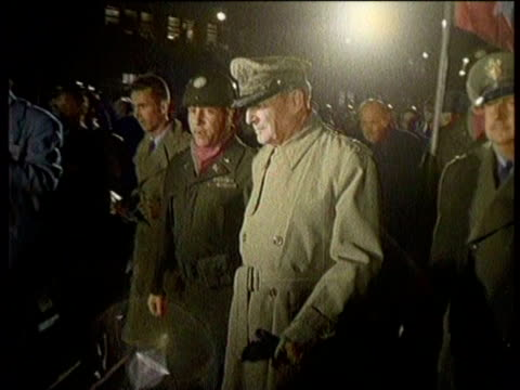 newsreel / no audio / truman fires macarthur for conflicting statements with administration in 1951 / overseas soldiers stand at attention on a... - general macarthur stock videos and b-roll footage